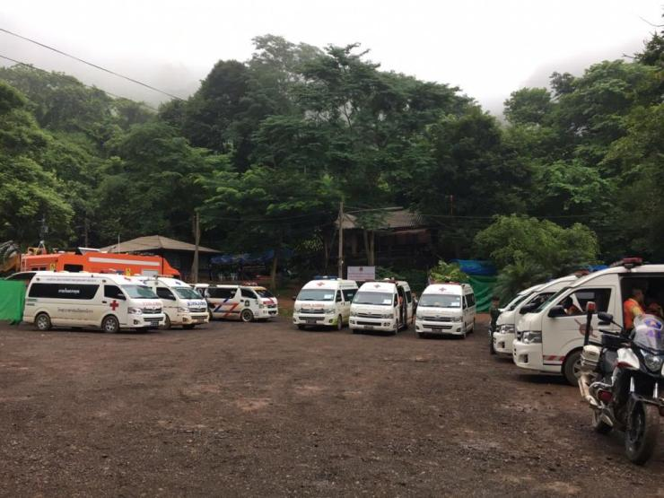 Ambulances inside the cave rescue compound