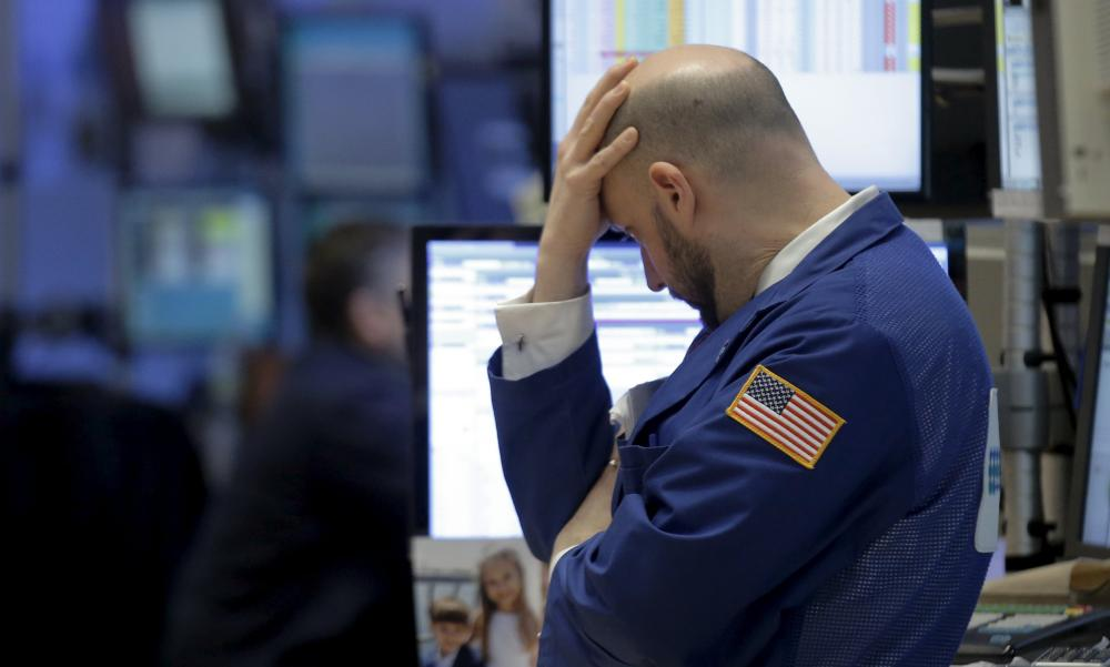 Traders at the New York Stock Exchange : US confidence slips as markets slump.
