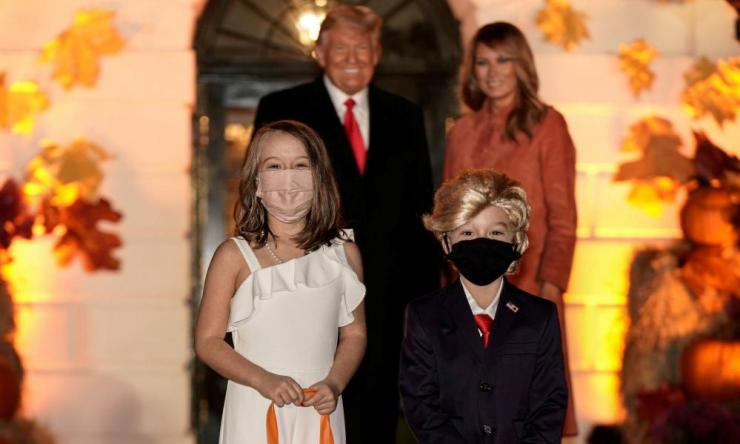 Children dressed as US President Donald Trump and US first lady Melania Trump attend a Halloween event hosted by President Trump and the first lady at the White House in Washington, US, 25 October 2020.