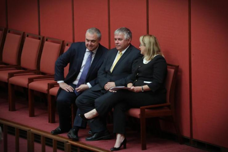 Nick Xenophon Team members Rebekha Sharkie, Stirling Griff and Rex Patrick watch as South Australian independent senator Tim Storer is sworn in