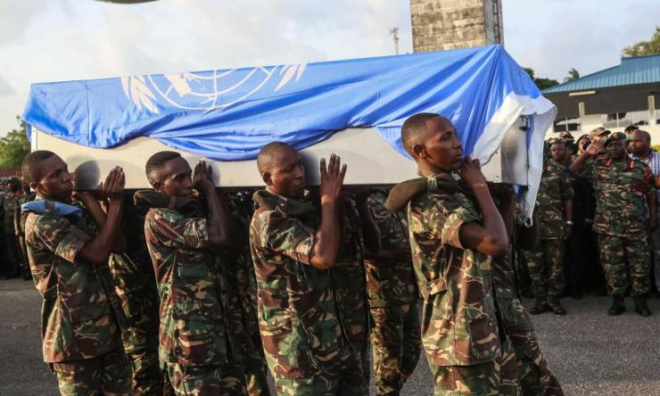 Soldiers carry coffin of Tanzanian peacekeeper killed in DRC.