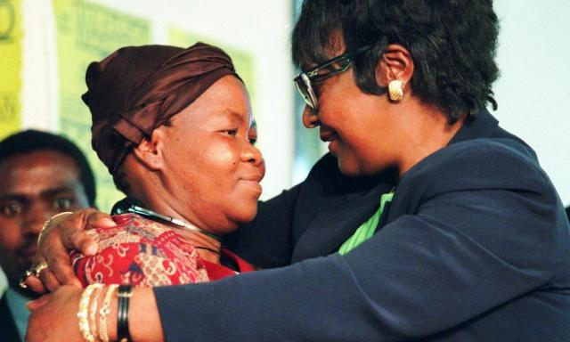 Winnie Mandikizela-Mandela (right) hugs Joyce Seipei, the mother of a murdered teenage activist, at a truth and reconciliation commission hearing in Johannesburg in 1997