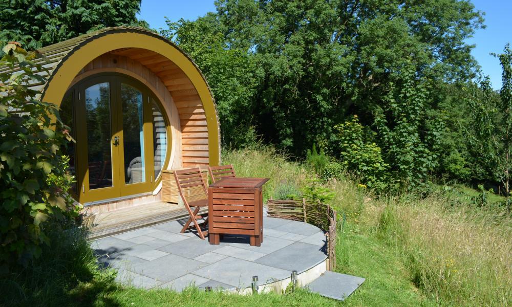 single, circular cedar-clad pod at Ty Barcud