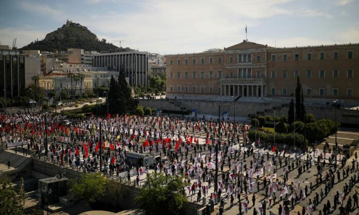 Members of the communist-affiliated trade union PAME wearing protective masks and gloves practise social distancing during a rally commemorating May Day in Athens.