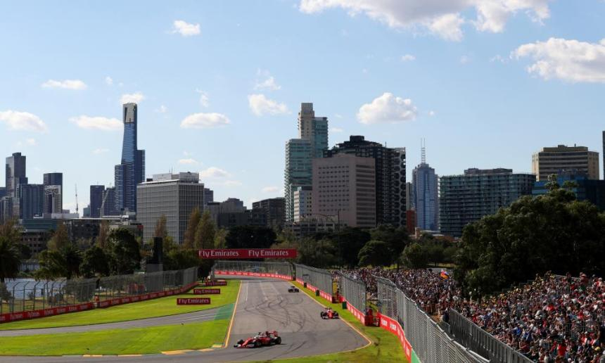Ferrari's Sebastian Vettel turns in front of the Melbourne cityscape.