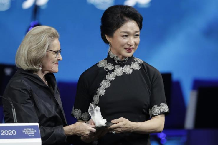 Dancer and coreographer Jin Xing, from China, receives a Crystal Award.