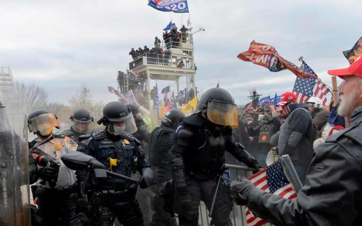 Trump supporters clash with police and security forces as they storm the US Capitol.