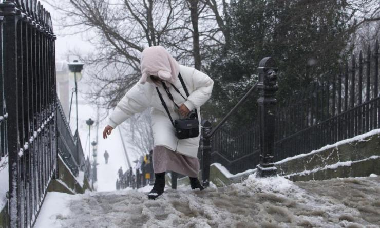 A woman struggles on icy steps in Edinburgh