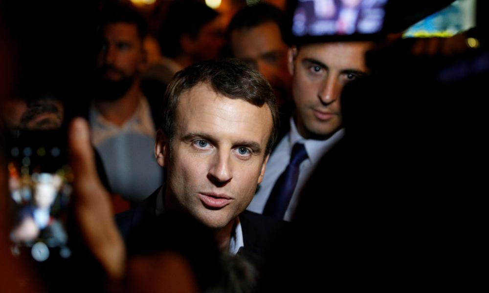 Emmanuel Macron talks to journalists after the first round of the presidential election