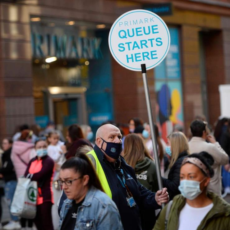 Shoppers queue ouside Primark in Belfast as shops reopen and hospitality is able to open outdoors in Northern Ireland.