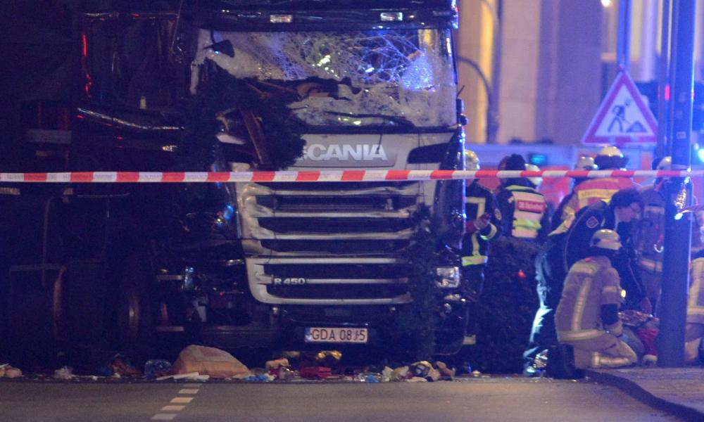 Rescue workers inspect the scenes and the truck that crashed into a Christmas market, close to the Kaiser Wilhelm memorial church in Berlin, Germany.