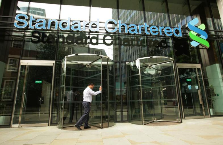 "Standard Chartered assessment<br>File photo dated 07/08/12 of the Standard Chartered building in London as their new boss Bill Winters delivered a withering assessment of the way the bank was run in the past, announcing a 44% slump in half-year profits. PRESS ASSOCIATION Photo. Issue date: Wednesday August 5, 2015. The chief executive said the Asia-focused lender's aggressive expansion had ""exposed the group to losses and fraud"" as he set out plans for a shake-up. See PA story CITY Standard. Photo credit should read: Yui Mok/PA Wire"
