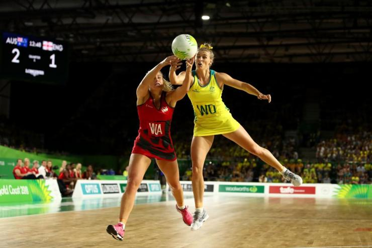 Gabi Simpson of Australia (R) and Chelsea Pitman of England compete for the ball during the Netball Gold Medal Match on day 11 of the Gold Coast 2018 Commonwealth Games.