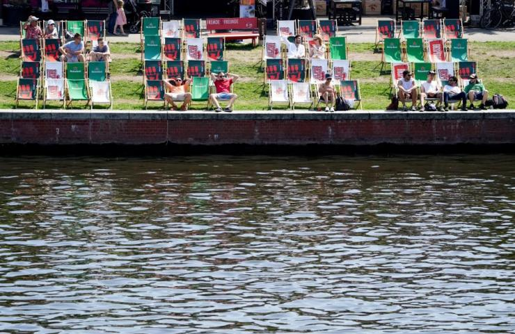 Only a few sun chairs at the river Spree are occupied today in Berlin, Germany.
