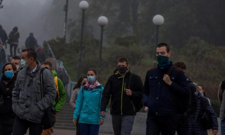 People wear masks in Warsaw as infections rise in Poland.