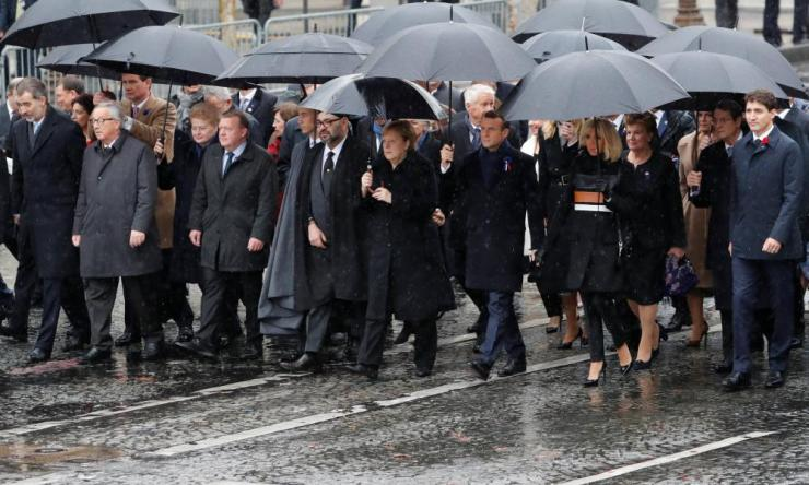 French President Emmanuel Macron, his wife Brigitte, German Chancellor Angela Merkel, Canada's Prime Minister Justin Trudeau, Lithuania's President Dalia Grybauskaite, King Felipe VI of Spain, Denmark's Prime Minister Lars Lokke Rasmussen, European Commission President Jean-Claude Juncker and other heads of states and governments arrive to attend a commemoration ceremony for Armistice Dayin Paris.