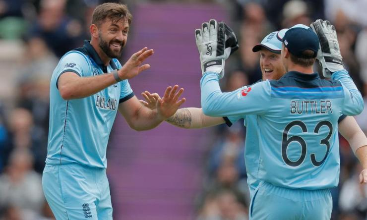 England's Liam Plunkett (left) celebrates taking the wicket of Chris Gayle of West Indies with a catch from Jonny Bairstow .