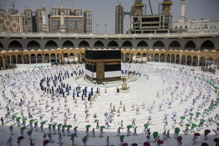 Pilgrims circling the cube-shaped Kaaba in the first rituals of the hajj.