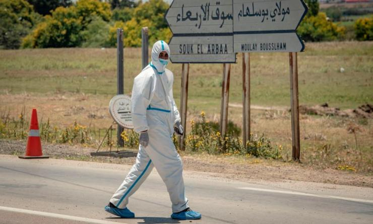 A member of the medical staff walks around during his break in the town of Moulay Bousselham, north of the capital Rabat, on June 20, 2020, as authorities received around 700 COVID-19 patients.