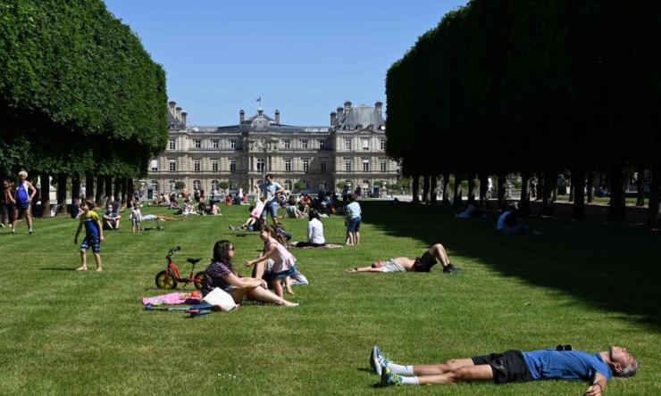People on the lawns of Jardin du Luxembourg park, in Paris, on the first day of reopening following the nationwide lockdown.