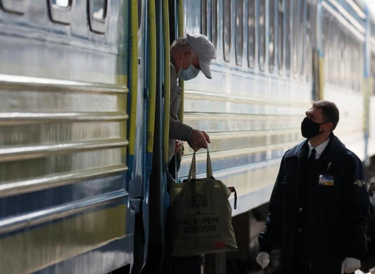 A passenger leaves a train in Kiev.