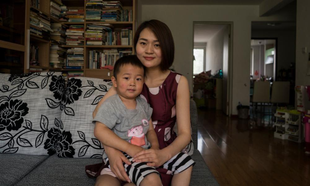 Li Wenzu, 31, wife of imprisoned lawyer Wang Quanzhang poses with their son Wang Guangwei, aged three.