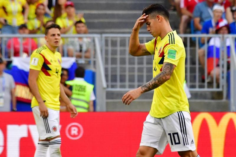 Colombia's midfielder James Rodriguez reacts as he leaves the pitch.