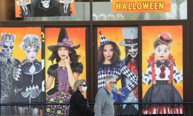 People walk past a Halloween shop in Montreal
