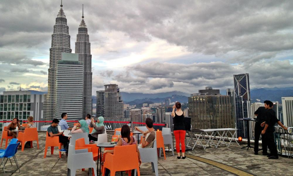 Daytime view of the helicopter landing pad bar, called Heli, with a view over Kuala Lumpur, Malaysia.