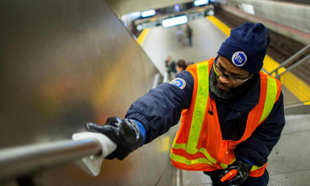 An MTA worker disinfects a subway station in the Manhattan borough of New York City, 4 March 2020.