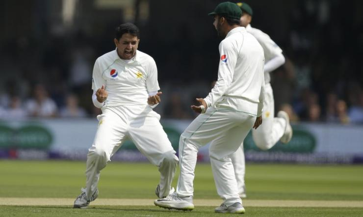Abbas, left, celebrates after taking the wicket of England's Jos Butler lbw.
