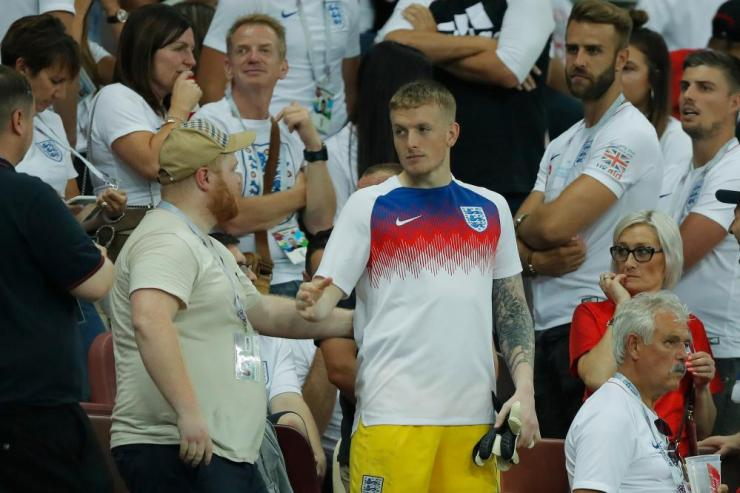 Jordan Pickford receives commiserations after heading up into the stands to see his family.