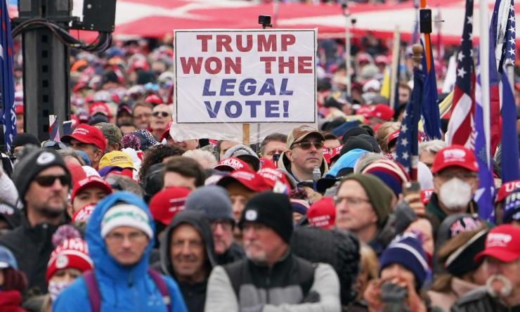 People listen to Trump speak near the White House on 6 January.