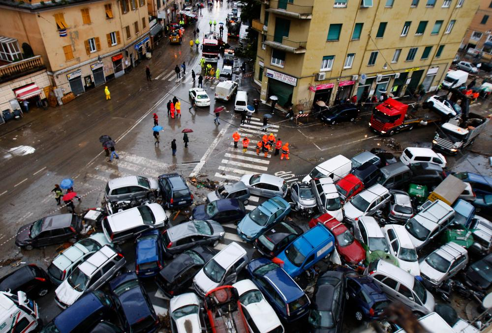 Cars that were swept into a pile by torrential rains on a street in Genoa, Italy in 2011