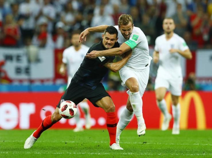 Harry Kane is shoved to the groud by Dejan Lovren.