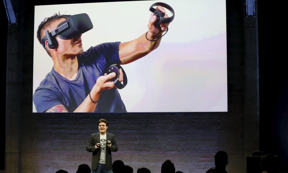 Oculus Founder Palmer Luckey displays an Oculus Touch input during an event in San Francisco, California.