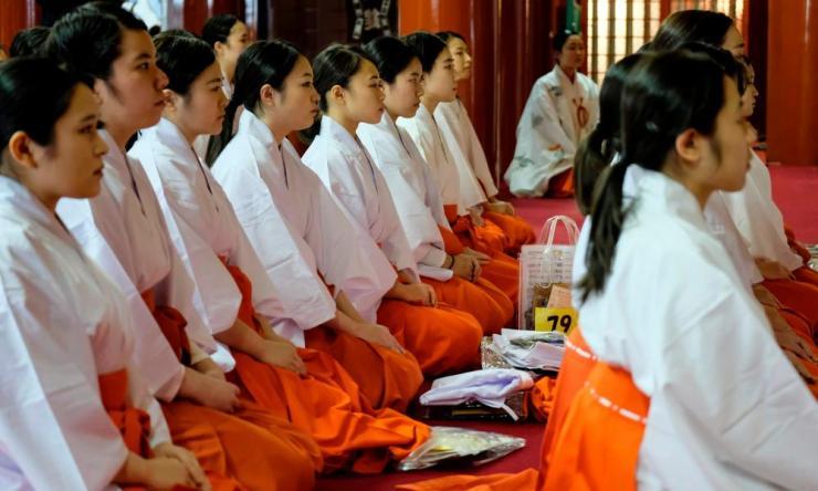 Japanese priestesses prepare for new year prayers at Kanda Myojin Shrine in Tokyo.