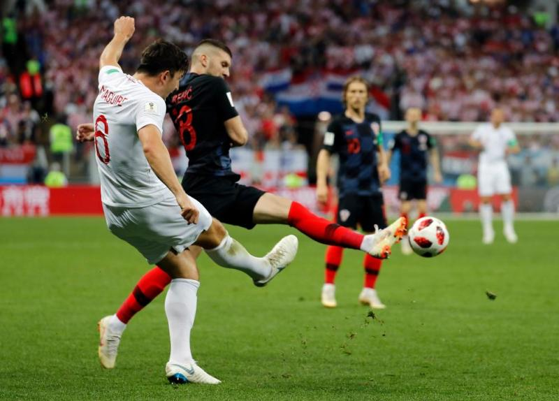 Harry Maguire of England passes the ball past the outstretched boot of Ante Rebic.