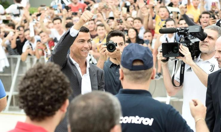 Cristiano Ronaldo greets fans in Turin.