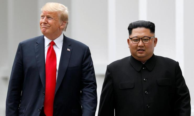 "Trump and Kim walk out of the Capella hotel after their working lunch. On this walk Trump told reporters that the two men would proceed to a ""signing"", although it is still unclear what is being signed."