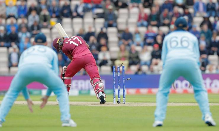 West Indies Evin Lewis is bowled by Chris Woakes of England.