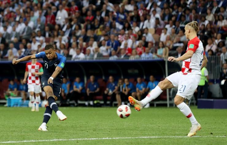Mbappe scores the fourth for France.