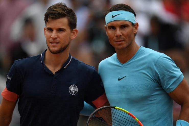 Thiem and Nadal pose as they arrive on the court.