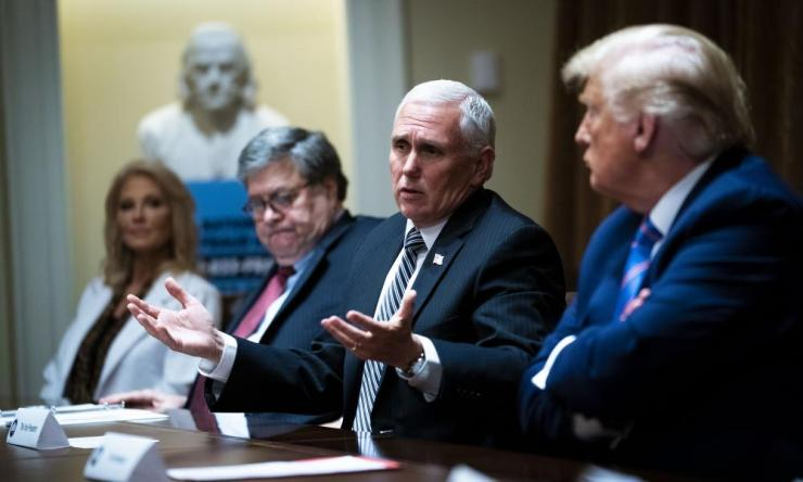 Mike Pence (second right) speaks as Donald Trump (far right) looks on during a roundtable about senior citizens in the cabinet room of the White House