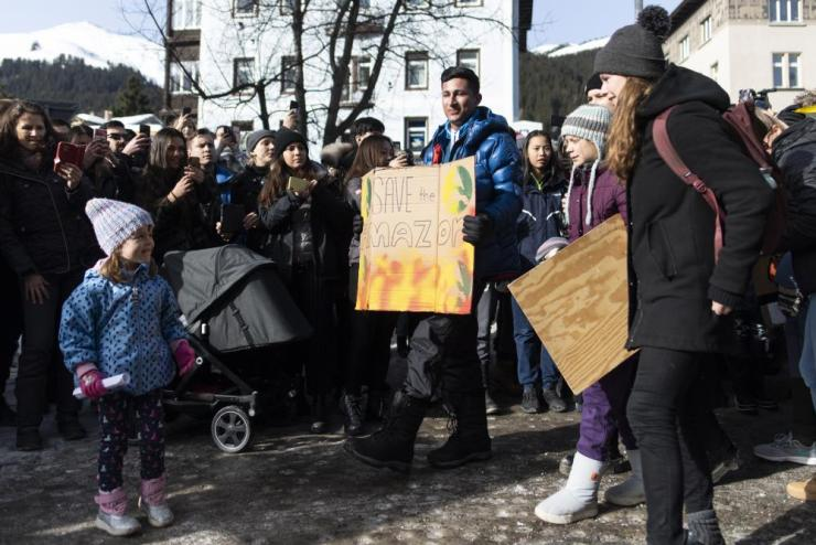 """Swedish climate activist Greta Thunberg, second right, arrives for a """"Fridays for Future"""" demo on the final day of the 50th annual meeting of the World Economic Forum, WEF, in Davos, Switzerland, Friday, Jan. 24, 2020. (Gian Ehrenzeller/Keystone via AP)"""