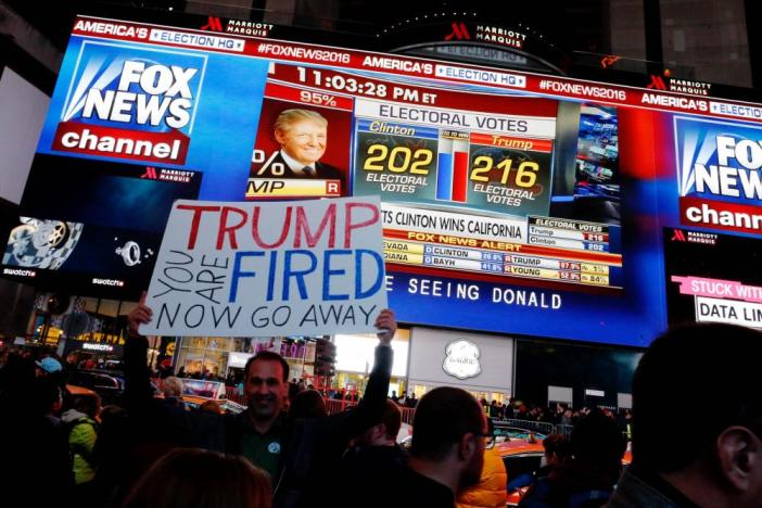 People gather around Times Square to view televised results of the US presidential election.