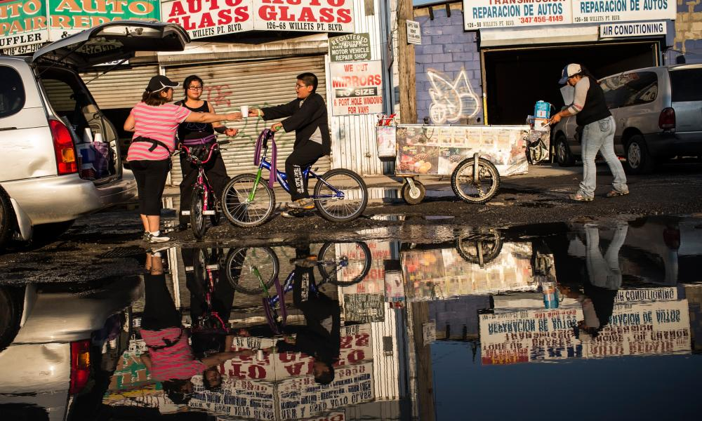 Cars, children on bikes and push carts navigate the flooded streets of Willets Point, in another picture from 2013.