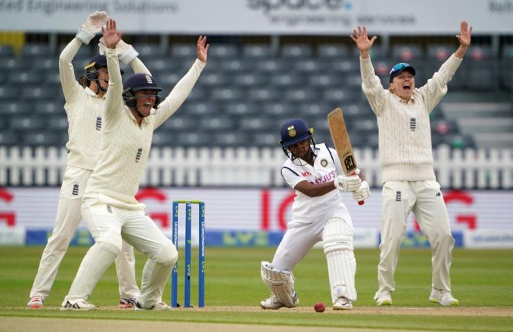 England appeal for LBW on India's Punam Raut.