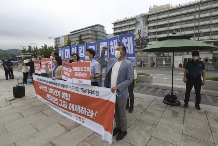 "Protesters stage a rally to oppose a planned visit by U.S. Deputy Secretary of State Stephen Biegun near the US Embassy in Seoul. The letters read ""We demand the dissolution of the US and South Korea working group."""