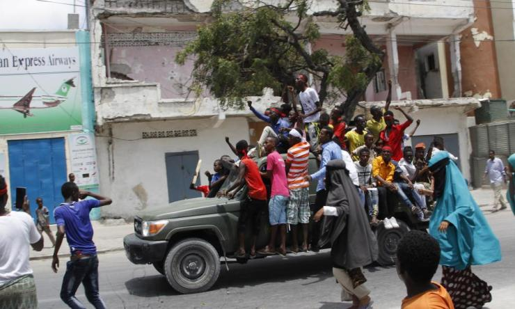 Protesters near the scene of the massive truck bomb attack in Mogadishu.